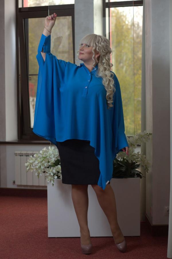 Рубашка-пончо. Свободного покроя. Застежка на планке, до уровня груди. Воротник рубашечный, на стойке. Рукав на широком манжете размер: единый. Цвета: синий, коралловый, голубой